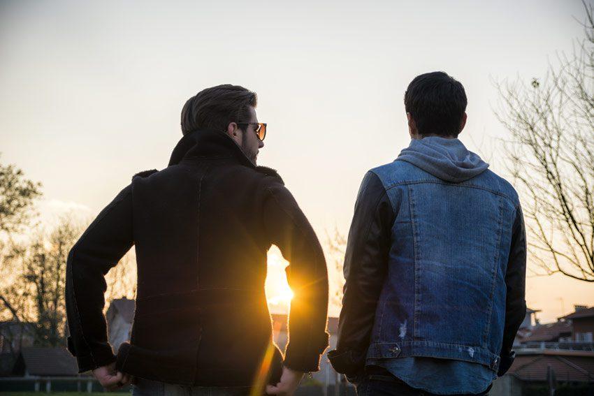 two men talking at dusk