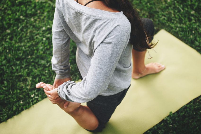 woman doing yoga - holistic treatment